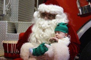 Kevin Spradlin | PeeDeePost.com Ryder Stewart, 3 months, son of Roger and Jessica Stewart, enjoys a visit with Santa Claus.