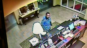Aberdeen police seek your help in identifying a Hampton Inn robbery suspect. Click on image for larger version.