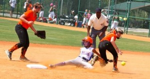 Jadyn Johnson slides safely into second – then third and home – to score Rockingham's first run of the game. Johnson scored two of her squad's four runs in a 4-3 victory Monday over Fuquay Varina.