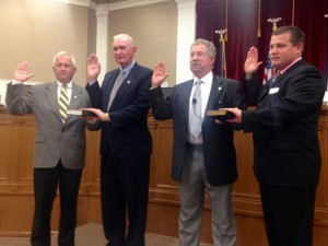 Kevin Spradlin | PeeDeePost.com Commissioner Herb Long, Commissioner Thad Ussery, Commissioner Don Bryant and Commissioner Ben Moss take their oaths of office from Clerk of Superior Court Vickie Daniel Monday evening before the board's regular 5:30 p.m. meeting.