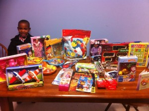 Submitted photo Marcus Thomas Henderson, 7, shows that $86 goes a long way in providing books, toys and crayons for children inside the visitation room at the Richmond County Department of Social Services.