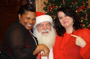 Stephanie Spradlin | PeeDeePost.com Nikki Ellerbe, left, and Christie Robson were all smiles, along with Santa Claus, during a Christmas celebration Saturday at The Hive Recreation Center in East Rockingham.