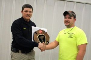 Kevin Spradlin | PeeDeePost.com Chief Edward Causey presents Michael Broadwater with the Fireman of the Year award at the Northside Volunteer Fire Department's annual banquet.