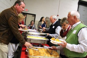 Kevin Spradlin | PeeDeePost.com County Commissioner Kenneth Robinette, left, and Commissioner Herb Long, right, work their way through the buffet line.