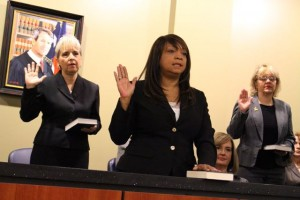 Kevin Spradlin | PeeDeePost.com Yvette Potts, center, was one of six assistant clerks sworn in Monday by Vickie Daniel. Potts has submitted her retirement papers, effective Feb. 1, 2015.
