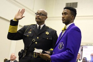 Kevin Spradlin | PeeDeePost.com Sheriff James Clemmons Jr. and his son, James, keep their hands on a Bible as the sheriff takes the oath of office for a second four-year term. The oath was performed by  North Carolina Supreme Court Justice Cheri Beasley.