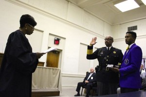 Kevin Spradlin | PeeDeePost.com North Carolina Supreme Court Justice Cheri Beasley recites the oath of office, repeated by Sheriff James Clemmons Jr., on Monday inside the old Richmond County courthouse.