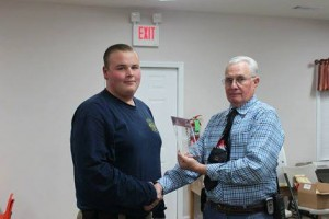 Submitted photo Brenden Watson, left, accepts the Junior Fireman of the Year award from Assistant Chief Bill Bayless.