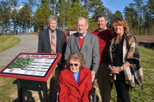 Wylie Bell | Richmond Community College Members of the Kindley family, including Mary Ellen, front, and G.R., second from left, stand at the trailhead outside the Forte Building.
