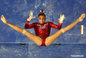 Photo by Xinhua / Wang Yuguo | English.Sina.com Ashton Locklear of Team USA performs on the uneven bars during the women's team final of the 45th Gymnastics World Championships in Nanning, capital of south China's Guangxi Zhuang Autonomous Region, Oct. 8, 2014. Team USA won the title with a total of 179.280 points.