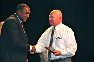 Kevin Spradlin | PeeDeePost.com Steve Wood, of Richmond Senior High School, was named Richmond County Schools Assistant Principal of the Year. He's pictured with Dennis Quick, executive director of auxiliary services.