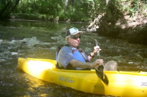 Kevin Spradlin | PeeDeePost.com Rockingham Mayor Steve Morris guides his kayak through some rapids as he approaches the take-out point along Hitchcock Creek at Steele Street.