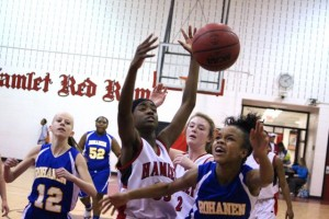 Kevin Spradlin | PeeDeePost.com Hamlet's Kennedy Alexander's defense and four points helped the Red Rams to a 49-28 victory over the Rebels.