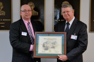Submitted photo RCC President Dr. Dale McInnis (left) presents Bill Council with a plaque commemorating his retirement from the college.