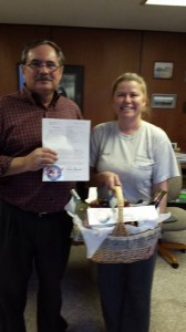 Submitted photo Rockingham attorney -John Daniel receives a basket of goodies from Wheels4Paws President Amy Jo Kuhnen Tuesday in a brief visit to his Broad Avenue office.