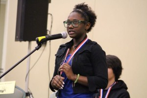 Kevin Spradlin | PeeDeePost.com Daleesia McDonald, of Ellerbe Middle School, expels her anxiety by fiddling with her school bee champion medal.