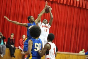 Kevin Spradlin | PeeDeePost.com Joraile White goes for the jumper to help lead Hamlet past Rohanen.