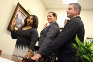 Kevin Spradlin | PeeDeePost.com Danita McNeill, Holly C. Smith and Robert Smith take the oath of a magistrate Thursday morning.