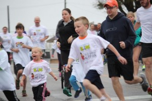 Younger runners take their first right turn in the Big Fun Run last year in downtown Rockingham.