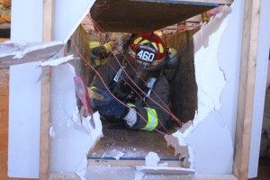 Kevin Spradlin | PeeDeePost.com Firefighters learned the value of having the necessary tools on their person, and not on the truck, to break through common obstacles such as sheetrock.