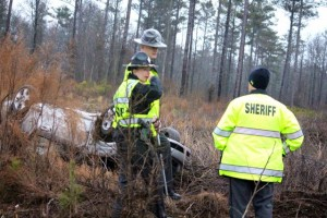 Kevin Spradlin | PeeDeePost.com North Carolina Highway Patrol troopers Goodwin and Carter (center), along with a Richmond County sheriff's deputy, discuss the details of a single-vehicle car accident Tuesday afternoon on Ledbetter Road.