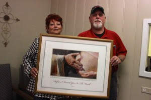 Kevin Spradlin | PeeDeePost.com Gene and Ferre Cummins, of Rockingham, donated a painting to the Pee Dee Pregnancy Resource Center in Rockingham.