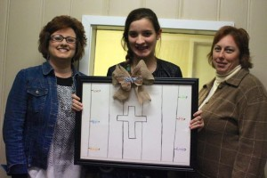 Kevin Spradlin | PeeDeePost.com Maddie Edmonds, center, stands with Jatana McCormick, center directo, left,  and Amy Anderson during the presentation of a framed drawing for the center.