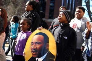 Kevin Spradlin | PeeDeePost.com Aneema Owens and Andrew Streeter, both 6 and of Rockingham, carry a likeness of Dr. Martin Luther King Jr. the 0.4 miles from First United Methodist Church to the old Richmond County courthouse on Saturday in downtown Rockingham.