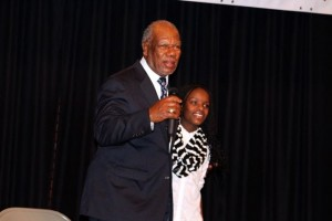 "Kevin Spradlin | PeeDeePost.com Rev. Tommy Legrand stands with his granddaughter, Raven Newton, on stage after Newton performed ""Encourage Yourself."""