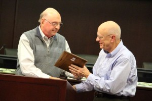 Kevin Spradlin | PeeDeePost.com Dr. John Stevenson, left, president of the Richmond County Historical Society, thanks outgoing board member Tom MacCallum for his years of service with a plaque of appreciation.