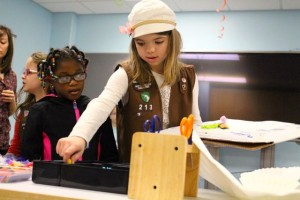 Kevin Spradlin   PeeDeePost.com A member of Girl Scout Troop 213, Rockingham, works through the supply table to stock up on the necessary items to create her team's invention.