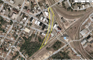 This Google Maps image shows, in yellow, the portion of CSX-owned property on which the city of Hamlet put down a parking lot. The price tag could be in the neighborhood of $160,000. Click on image for larger version.