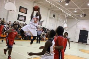 Kevin Spradlin | PeeDeePost.com Bobby Terry in air for the Rockets. Terry finished with 15 points in the win.