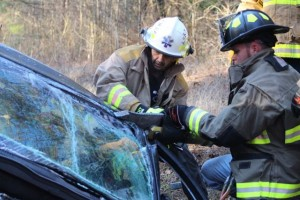 Kevin Spradlin | PeeDeePost.com Rescue personnel use the jaws of life to extricate the trapped driver of a Chevy Cruz involved in a head-on collision Thursday morning on Haywood Parker Road.
