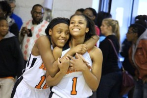 Kevin Spradlin | PeeDeePost.com Ralayah McCrae and Taliah Wall celebrate their team's Southeastern Middle School Conference championship.