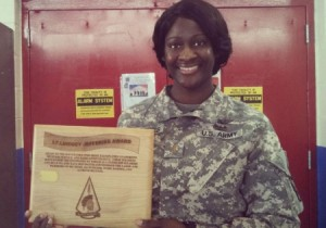 "Courtesy photo by Army 2nd Lt. Lindsey Jefferies Army 2nd Lt. Lindsey Jefferies, a Black Hawk helicopter pilot with the North Carolina National Guard's C Company, 1st Battalion, 131st Aviation, 449th Theater Aviation Brigade, holds a plaque that bears her name. The award is given to the RSP soldier who most exemplifies leadership, selfless-service, dedication to duty and those who raise the standards by which all other RSP soldiers are to be evaluated. ""I think that Lt. Jefferies' success serves as inspiration to hundreds of young soldiers who are exploring their own future,"" said 1st Sgt. Robert Cook, a senior noncommissioned officer with the Recruiting and Retention Battalion, 60th Troop Command, who was part of Jefferies' cadre."