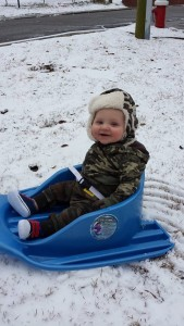 Lucas Allred, 6 months, enjoys his first snow with parents Will and Allison Allred in Rockingham.