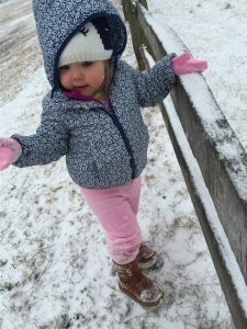 Claire Stedman shrugs off her worldly concerns to enjoy the falling snow in Rockingham. Photo by Jessica Stedman.