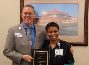 Submitted photo Stephanie Hudson accepts the Employee of the Year award from Sandhills Regional Medical Center CEO David Clay.