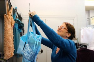 Kevin Spradlin | PeeDeePost.com Lori Wright, new owner of Rockingham Trends Consignment and Boutique, hangs a prom dress to be on display in time for the Spring season.