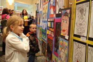 Kevin Spradlin | PeeDeePost.com Emmaleigh Hoffman, of Cordova, admires the artwork of other students on display at Cole Auditorium.