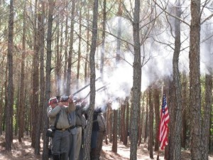 A Richmond County Historical Society photo A military gun salute by Civil War re-enactors is performed at a ceremony in Richmond County when tombstones for five Union Cavalry foragers killed in March 1865 finally marked their graves in October 2010.