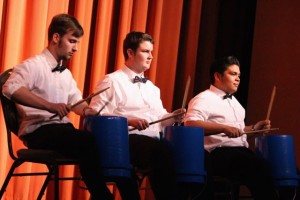 "Kevin Spradlin | PeeDeePost.com Raider percussionists Angelis Hernandez (student director), Cameron Mabe and Alec Rushing nearly stole the show with a paint bucket rendition of ""Rin Tin Tin."""