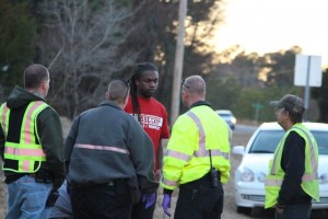 Kevin Spradlin | PeeDeePost.com FirstHealth EMS personnel evaluate a driver after he was involved in a rollover Saturday on Northside Drive. The driver said he was thankful he had his seatbelt on.