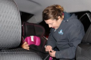 Kevin Spradlin | PeeDeePost.com Amy Hamilton-Forrester, outreach manager for FirstHealth Community Services in Richmond County, helps to correctly install a carseat in the back of Tina Hood's vehicle for her 3-year-old granddaughter.