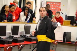 Kevin Spradlin | PeeDeePost.com David Rathfon in a Japanese kimono explains to students who have just entered the Hamlet Middle School media center where to go and what to expect.