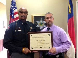 Kevin Spradlin | PeeDeePost.com Det. Gary C. Carter Jr. is congratulated by Richmond County Sheriff James Clemmons Jr. for earning his Criminal Investigation Certificate Program at the North Carolina Justice Academy.
