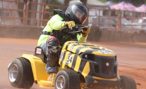 Kevin Spradlin | PeeDeePost.com A lawn mower racer handles the second turn of four on the Ellerbe Lions Club Speedway during the 2014 season.