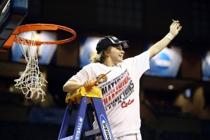 An NCAA Division II photo Kaitlynn helps cut down the net after the championship victory.