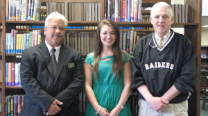 Submitted photo McKenzie Grimes, center, with Mike Perdue of Rockingham Moose Lodge (left) and RSHS Principal Keith McKenzie.